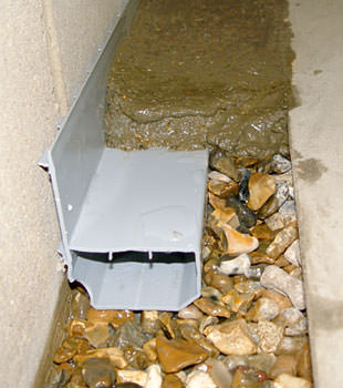 A basement drain system installed in a Leduc home